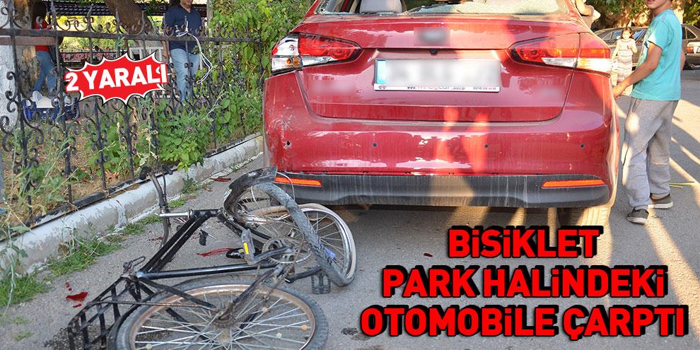Bisiklet, park halindeki otomobile çarptı: 2 yaralı