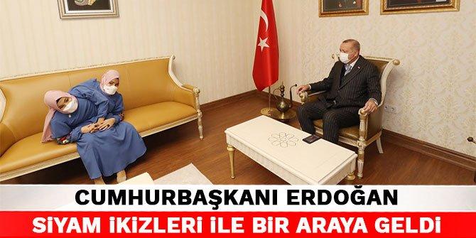 Cumhurbaşkanı Erdoğan siyam ikizleri ile bir araya geldi