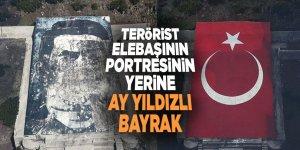 Terörist elebaşının portresinin yerine ay yıldızlı bayrak